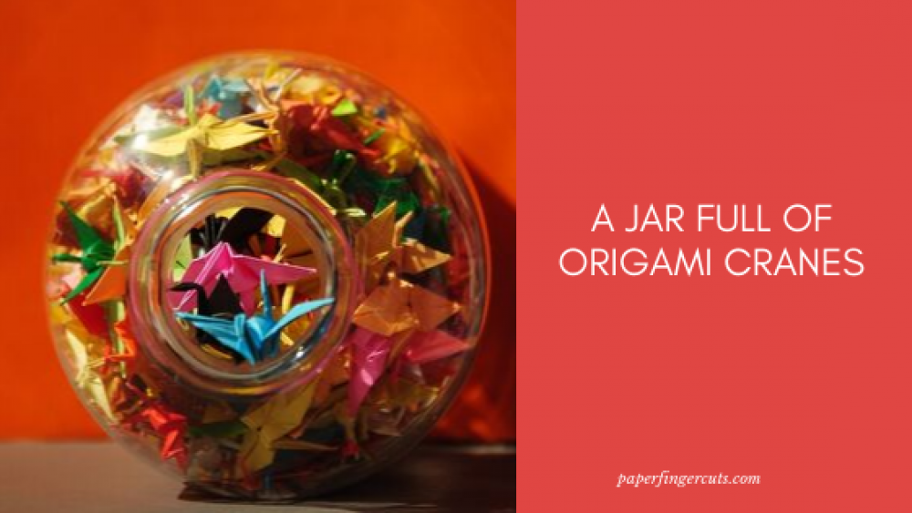 A Jar Full Of Origami Cranes